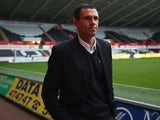 Gus Poyet the manager of Sunderland walks towards the dressing room area ahead of the Barclays Premier League match between Swansea City and Sunderland at the Liberty Stadium on October 19, 2013