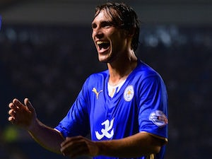 Leicester defender Ignasi Miquel celebrates a goal by Danny Drinkwater against Derby on September 24, 2013