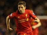 Joe Allen of Liverpool in action during the Capital One Cup Fourth Round match between Liverpool and Swansea City at Anfield on October 31, 2012