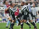 Newcastle United teammates Kieron Dyer and Lee Bowyer fight on the pitch in April 2005.