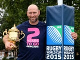 Former England rugby international, Lawrence Dallaglio poses with the Webb Ellis Cup on September 17, 2013