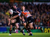 Thomas Waldrom of Tigers in action with Alberto Sgarbi of Treviso during the Heineken Cup match between Leicester Tigers and Benetton Treviso at Welford Road on October 18, 2013