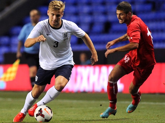 Luke Shaw of England (L) attacks during the 2015 UEFA European U21 Championships Qualifier between England U21 and Moldova U21 at The Madejski Stadium on September 5, 2013