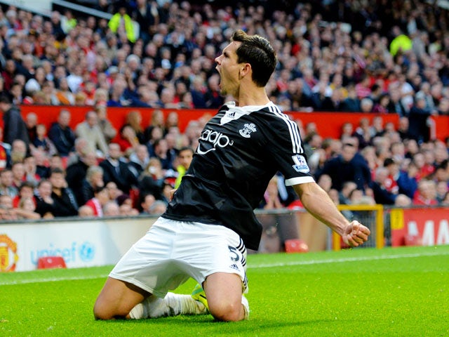 Dejan Lovren of Southampton celebrates after scoring a late goal to level the scores at 1-1 during the Barclays Premier League match between Manchester United and Southampton at Old Trafford on October 19, 2013