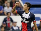 Paris Saint-Germain's Brazilian defender Marquinhos celebrates after scoring a goal during the French L1 football match between Paris Saint-Germain and Toulouse at the Parc des Princes Stadium in Paris on September 28, 2013