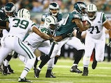 Matthew Tucker #39 of the Philadelphia Eagles is tackled by Danny Lansanah #47 of the New York Jets during their pre season game at MetLife Stadium on August 29, 2013