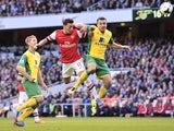 Arsenal midfielder Mesut Ozil scores against Norwich during the English Premier League football match between Arsenal and Norwich at the Emirates Stadium in London on October 19, 2013