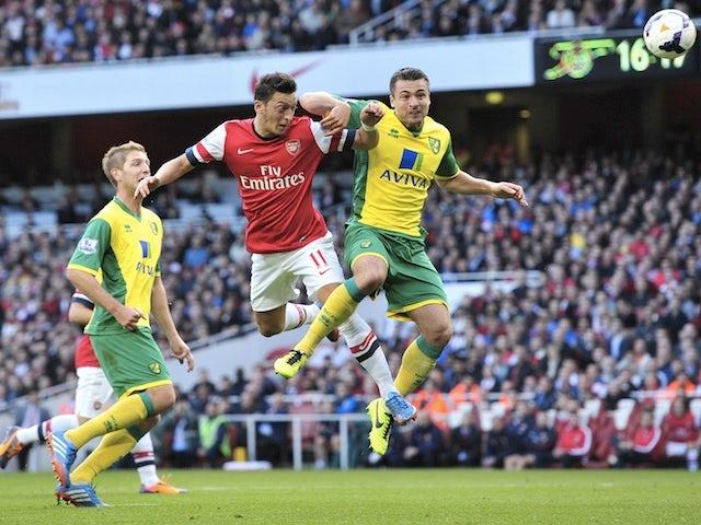 Result: Ozil brace hands Arsenal victory