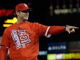 Manager Mike Matheny #22 of the St. Louis Cardinals celebrates after the Cardinals defeat the Los Angeles Dodgers 9-0 in Game Six of the National League Championship Series at Busch Stadium on October 18, 2013