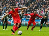 Steven Gerrard of Liverpool scores his 100th goal and Liverpool's first from the penalty spot during the Barclays Premier League match between Newcastle United and Liverpool at St James' Park on October 19, 2013