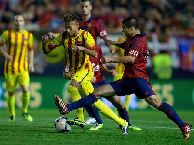 Barca striker Neymar competes for the ball with Francisco Andres Silva of CA Osasuna during the La Liga match on October 19, 2013