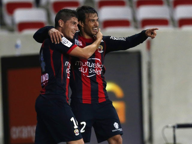Nice's Argentinian forward Dario Cvitanich and Nice's French forward Jeremy Pied celebrates after scoring a goal during the French L1 football match Nice (OGC Nice) vs Marseille (OM) on October 18, 2013