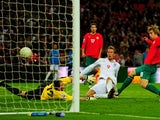 Peter Crouch scores for England against Belarus in October 2009.