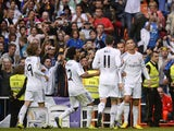 Real Madrid's Portuguese forward Cristiano Ronaldo celebrates after scoring during the Spanish league football match Real Madrid vs Malaga on October 19, 2013