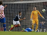 Robert Snodgrass of Scotland scores a goal during the World Cup 2014 qualifying football match between Scotland and Croatia at Hampden Park in Glasgow on October 15, 2013
