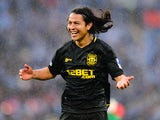 Roger Espinoza of Wigan Athletic celebrates victory after the FA Cup with Budweiser Final between Manchester City and Wigan Athletic at Wembley Stadium on May 11, 2013