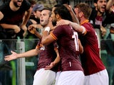 Miralem Pjanic with his team-mates of AS Roma celebrates after scoring the opening goal during the Serie A match between AS Roma and SSC Napoli at Stadio Olimpico on October 18, 2013