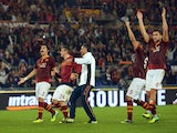 AS Roma's players celebrate at the end of the Serie A football match AS Roma vs Napoli on October 18, 2013