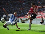 Ryan Flynn of Huddersfield Town battles with Matt Lowton of Sheffield United during the npower League One, playoff final between Huddersfield Town and Sheffield United at Wembley Stadium on May 26, 2012