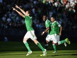Saint-Etienne's French midfielder Benjamin Corgnet celebrates with his teammates after scoring a goal during the French L1 football match AS Saint-Etienne (ASSE) vs Lorient (FCL) on October 20, 2013