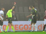 Inter Milan's Slovenian goalkeeper Samir Handanovic gets a red card from referee Daniele Doveri during the Serie A football match Torino vs Inter Milan on October 20, 2013