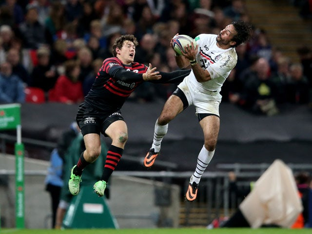 Clement Poitrenaud of Toulouse claims a high ball under pressure from Alex Goode of Saracens during the Heineken Cup pool three match between Saracens and Toulouse at Wembley Stadium on October 18, 2013