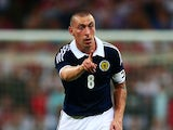 Scott Brown of Scotland gestures during the International Friendly match between England and Scotland at Wembley Stadium on August 14, 2013