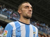 Sergi Darder of Malaga CF takes to the field during the La Liga match between Malaga CF and FC Barcelona at La Rosaleda Stadium on August 25, 2013