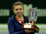 Romania's Simona Halep holds her trophy after her victory over Australia's Samantha Stosur in the Kremlin Cup tennis tournament final match in Moscow on October 20, 2013