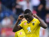 Sochaux' Senegalese midfielder Joseph Lopy celebrates after scoring a goal during the French L1 football match Sochaux (FCSM) against Monaco (ASM) on October 20, 2013