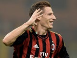 Valter Birsa of AC Milan celebrates scoring the first goal during the Serie A match between AC Milan and Udinese Calcio at Giuseppe Meazza Stadium on October 19, 2013