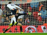 Wayne Rooney of England scores his team's opening goal during the FIFA 2014 World Cup Qualifying Group H match between England and Poland at Wembley Stadium on October 15, 2013