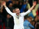 England's Wayne Rooney celebrates scoring against Poland on October 15, 2013
