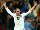 England's Wayne Rooney celebrates scoring against Poland on October 15, 2013