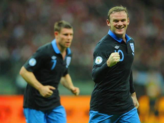 Wayne Rooney of England celebrates scoring to make it 1-0 during the FIFA 2014 World Cup Qualifier between Poland and England at the National Stadium on October 17, 2012