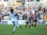 Wilfried Bony of Swansea City scores a penalty during the Barclays Premier League match between Swansea City and Sunderland at Liberty Stadium on October 19, 2013