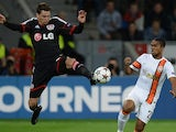 Leverkusen's Polish defender Sebastian Boenisch and Shakhtar Donetsk's Brazilian midfielder Douglas Costa vie for the ball during the UEFA Champions League group A match on October 23, 2013