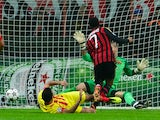 AC Milan's Brazilian forward Robinho kicks and scores during the Champion's League football match AC Milan vs FC Barcelona, on October 22, 2013