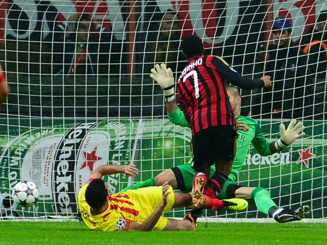 AC Milan's Brazilian forward Robinho kicks and scores during the Champion's League football match AC Milan vs FC Barcelona, on October 22, 2013
