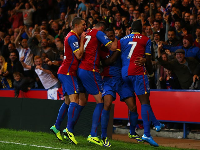 Crystal Palace's Adrian Mariappa is congratulated by team mates after scoring the opening goal against Fulham on October 21, 2013