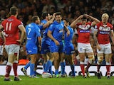 Italy's Aidan Guerra celebrates with his team after scoring the opening try against Wales during their World Cup match on October 26, 2013