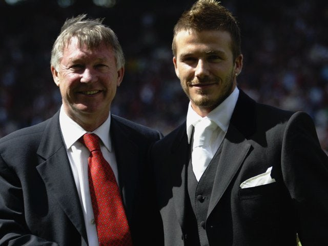 Alex Ferguson and David Beckham stand on the side of the Old Trafford pitch after the latter signs a new contract in May 2002.