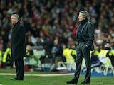 Alex Ferguson and Jose Mourinho stand on the Bernabeu touchline in February 2013.