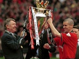 Alex Ferguson and Roy Keane lift the Premier League trophy aloft in May 2001.