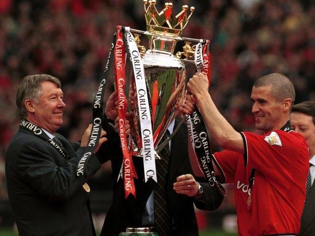 Alex Ferguson and Roy Keane lift the Premier League trophy aloft in May 2001.