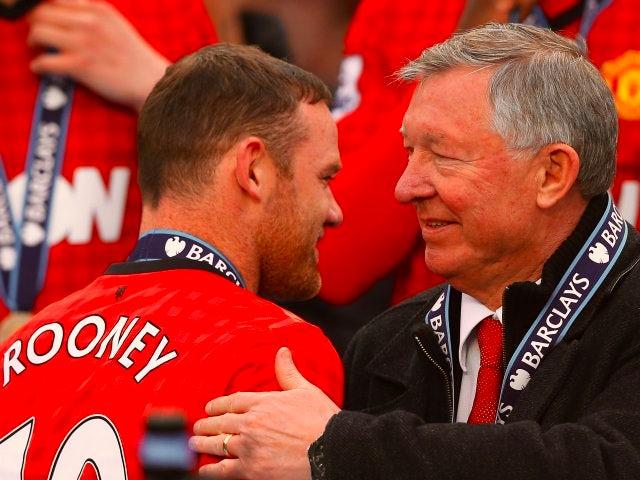 Alex Ferguson congratulates Wayne Rooney upon winning the Premier League title in May 2013.