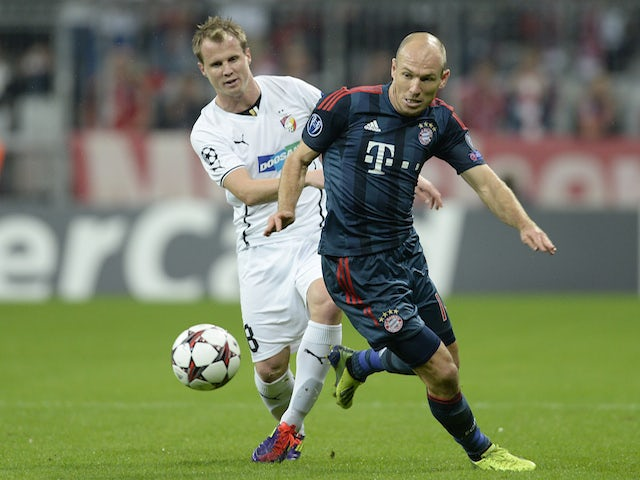 Vitoria Plzen's David Limbersky and Bayern Munich's Arjen Robben vie for the ball during the UEFA Champions League group D match on October 23, 2013