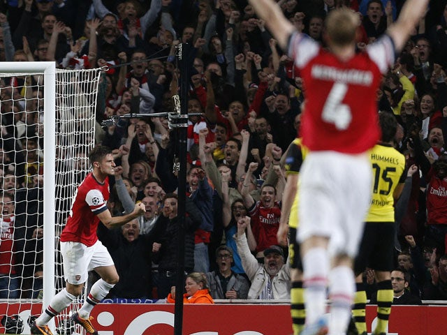 Arsenal's French striker Olivier Giroud celebrates scoring their first goal during the UEFA Champions League Group F football match between Arsenal and Borussia Dortmund at the Emirates Stadium, north London, on October 22, 2013
