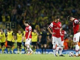 Arsenal's French striker Olivier Giroud and German midfielder Mesut Ozil react after Borussia Dortmund score their second goal during the UEFA Champions League Group F football match between Arsenal and Borussia Dortmund at the Emirates Stadium, north Lon