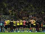 Borussia Dortmund players celebrate victory at the final whistle with his team mates during the UEFA Champions League Group F match between Arsenal and Borussia Dortmund at Emirates Stadium on October 22, 2013
